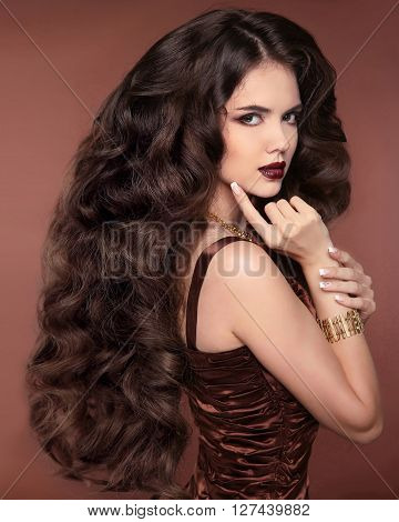 Healthy Long Hair. Beautiful Girl. Hairstyle. Makeup. Elegant Brunette Woman In Coffee Brown Dress W
