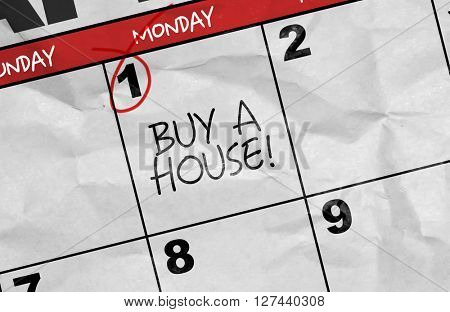 Concept image of a Calendar with the text: Buy a House