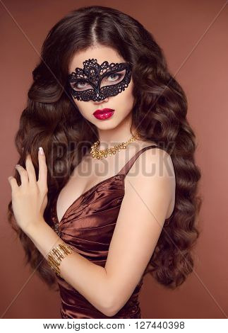 Hairstyle. Beautiful Young Woman In Black Mysterious Venetian Lace Mask And Coffee Brown Elegant Dre