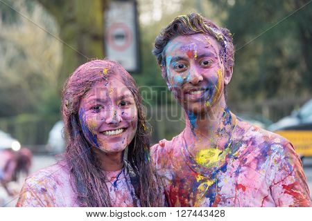 Cambridge,UK, March 11th 2016 Cambridge University students celebrate Holi, the Hindu festival of colour at Queens College Backs
