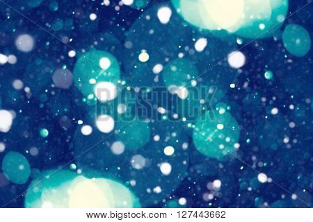 the christmas snowfall in the evening, natural boke background