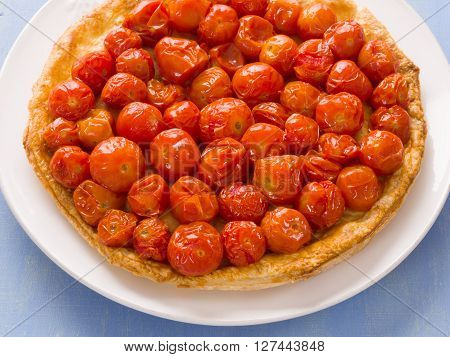 close up of rustic cherry tomato tarte tatin