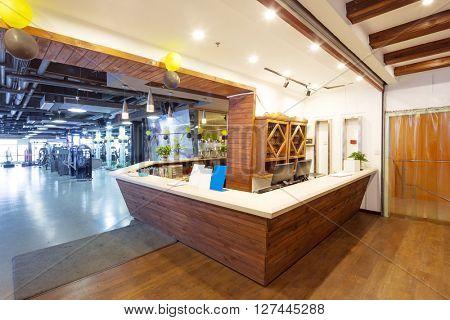 wood reception desk in modern gym