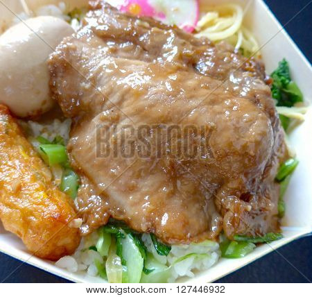 Lunch box with pork,stewed egg and vegetable closeup in Taiwan