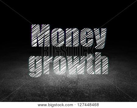 Banking concept: Glowing text Money Growth in grunge dark room with Dirty Floor, black background