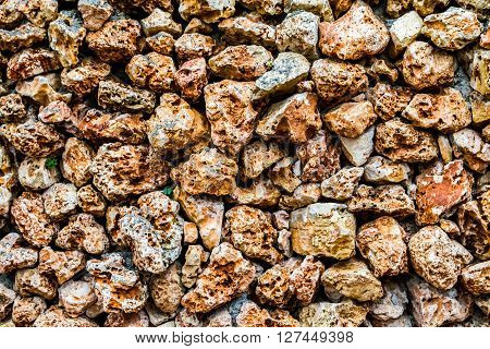 Fragment of stone wall with a porous surface texture of masonry