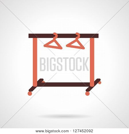 Brown clothes rack with two red hangers. Equipment for fashion store, laundry, wardrobe room. Flat color style vector icon. Web design element for site, mobile and business.