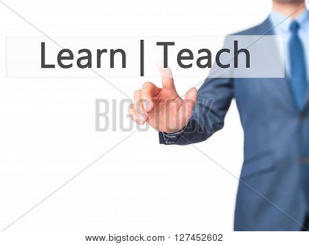 Learn Teach - Businessman Hand Pressing Button On Touch Screen Interface.