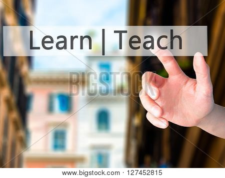 Learn Teach - Hand Pressing A Button On Blurred Background Concept On Visual Screen.