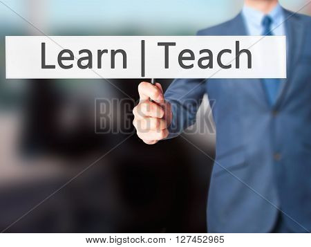 Learn Teach - Businessman Hand Holding Sign