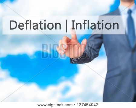 Deflation Inflation - Businessman Hand Pressing Button On Touch Screen Interface.