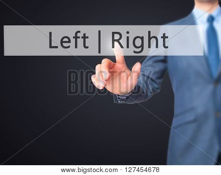 Left Right - Businessman Hand Pressing Button On Touch Screen Interface.