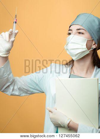 Nurse With Syringe And Folder