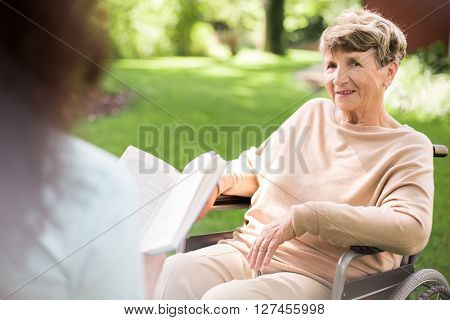Reading To Senior Woman