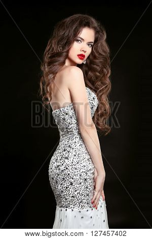 Beautiful Elegant Woman In Fashion Dress Isolated On Black Background. Makeup. Beauty Brunette Girl.
