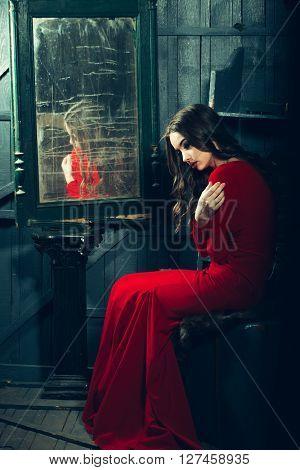 Woman In Red Dress Near Mirror