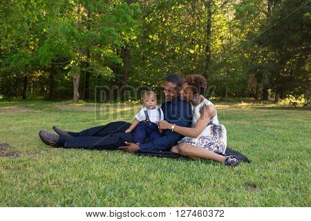 Parents holding their baby enjoying the outdoors