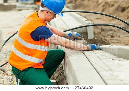 Image of athletic physical labourer paving street