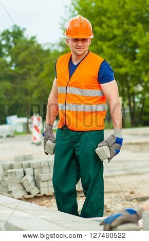 Builder In Uniform Holding Cobbles