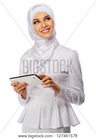 Muslim woman in white dress with tablet PC isolated