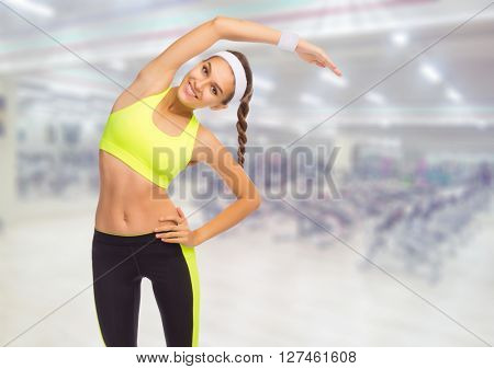 Sporty girl in fitness club