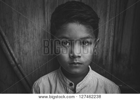 scared and alone, young h Asian child who is at high risk of being bullied and abused, selective focus