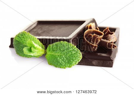 Chocolate with shavings and mint on white background