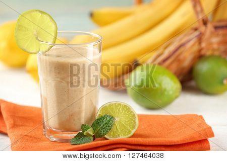 Fresh banana cocktail with chocolate on napkin
