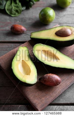 Sliced avocado on wooden cutting board