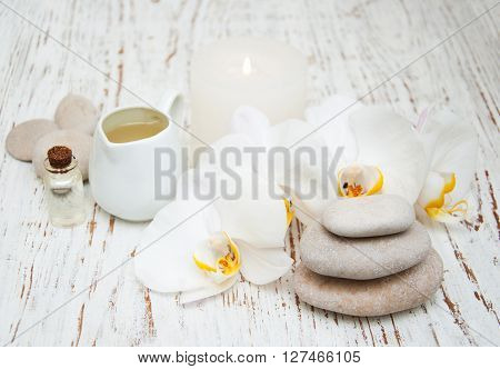 White Orchids With Massage Stones