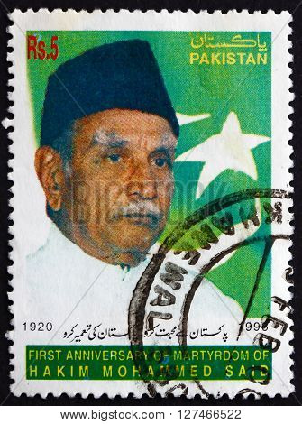 PAKISTAN - CIRCA 1999: a stamp printed in Pakistan shows Hakim Muhammad Saeed Physician Medical Researcher Scholar Philanthropist circa 1999