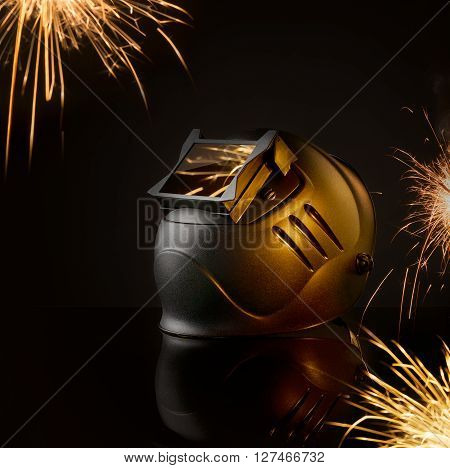 mask welder on the background of sparks from welding process