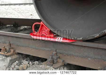 brake wheel on railway of train. Train shoe propped wheel train.