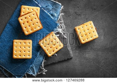 Tasty cookies with chocolate on dark background, close up