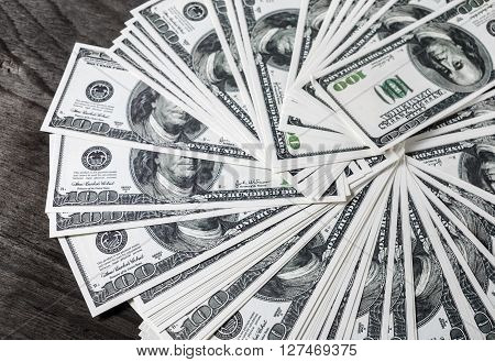 A lot of money. Money background. Pile of dollars. One Many one hundred dollar bills. Fake money. Business concept.
