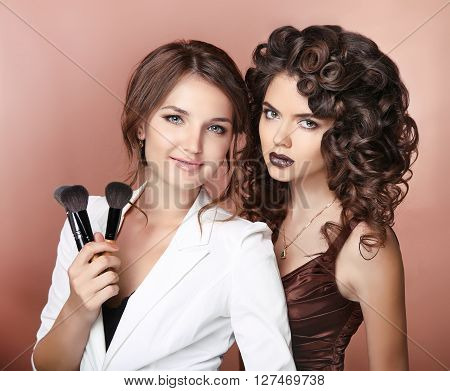 Artist. Healthy Hair. Makeup. Two Beautiful Brunette Girls With Long Curly Hairstyle. Vamp Lips. Ele