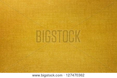 Image of yellow fabric as background close-up