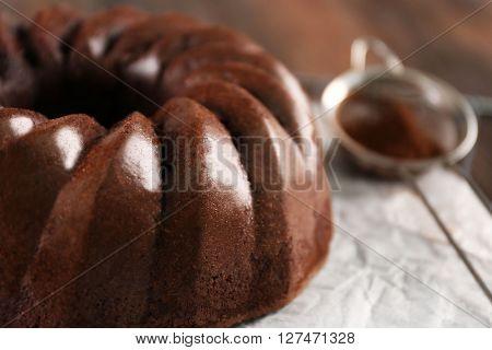 Chocolate cake on paper, closeup