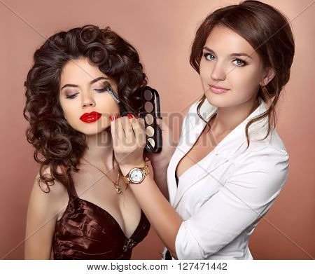 Beauty Makeup Artist Woman Applying Make Up Sensual Brunette Girl Model With Red Lips And Shiny Curl