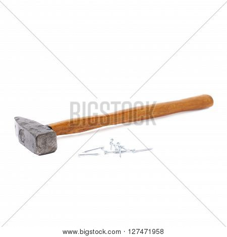 Big hammer with pile of metal nails over white isolated background