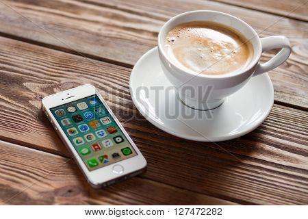 WROCLAW, POLAND - APRIL 12, 2016: Apple iPhone SE smartphone