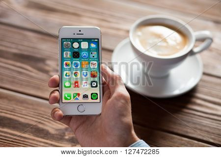 WROCLAW, POLAND - APRIL 12, 2016: Apple iPhone SE smartphone