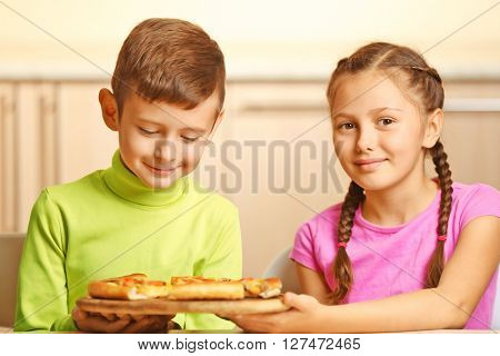 Children eating pizza at home