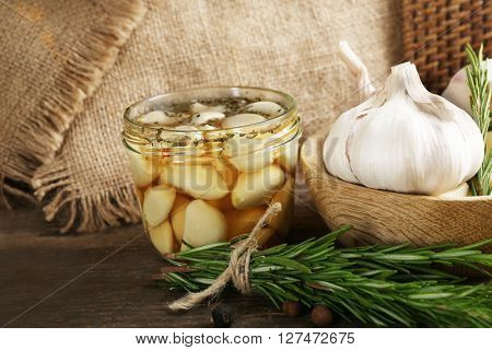 Garlic with spices on wooden table