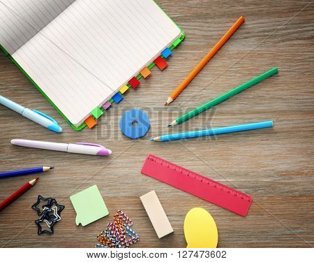 Dairy and other office supplies on wooden background, flat lay