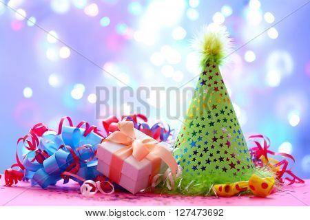 Party hat and other stuff on blurred garland background