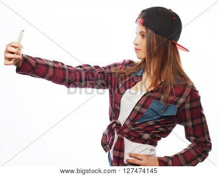 pretty teen girl wearing hat, taking selfies