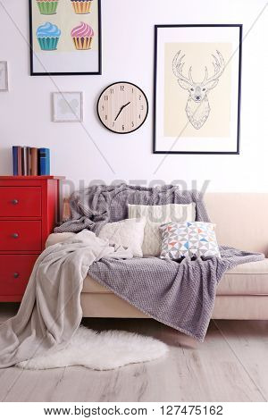 Beige sofa in the room interior