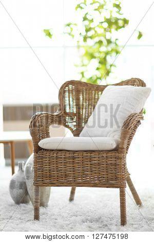 Design interior with wicker armchair indoors