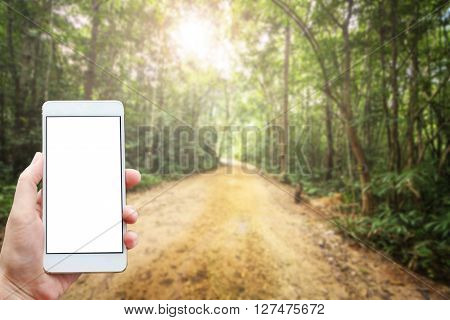 Business conceptual- Focused on left hand holding mobile with Trekking nature blurred background
